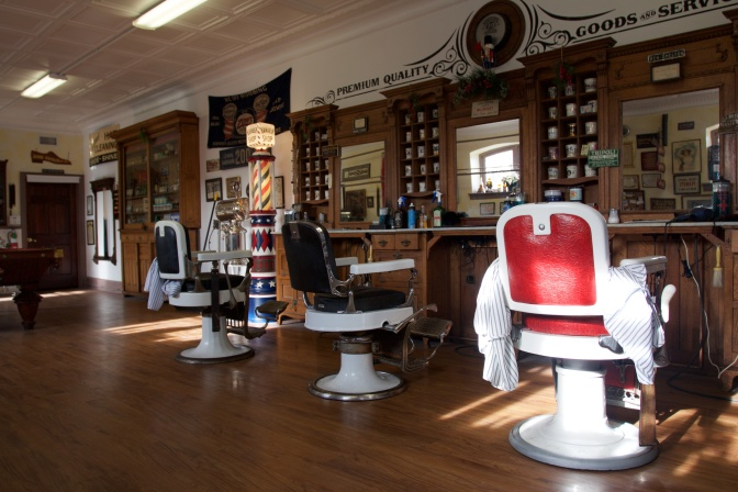 Interior of barbershop, with three barber's chairs.