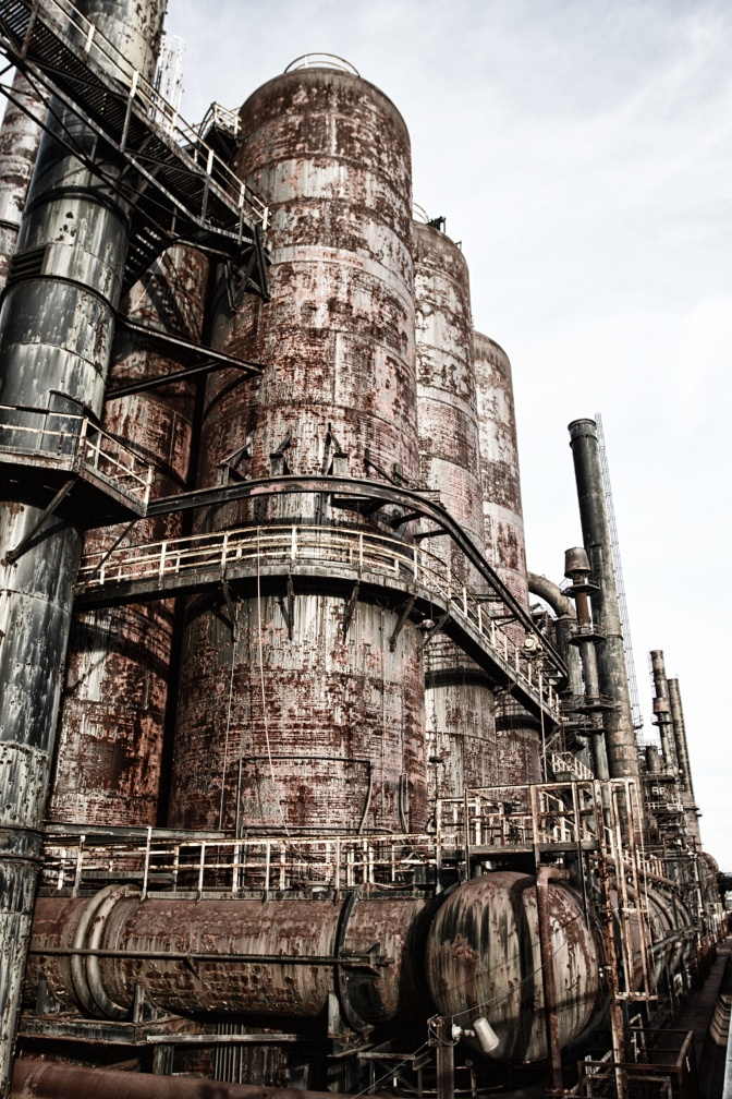 Photo of rusting steel stacks section.