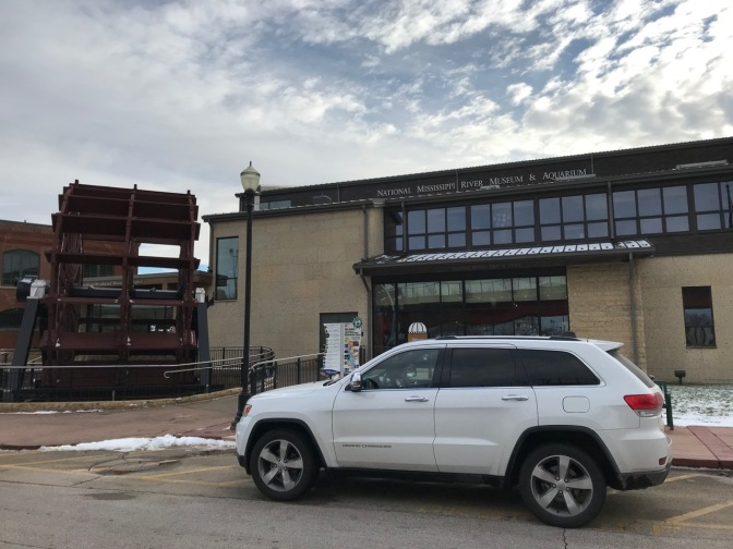 White Jeep Grand Cherokee in front of National Mississippi River Museum and Aquarium.