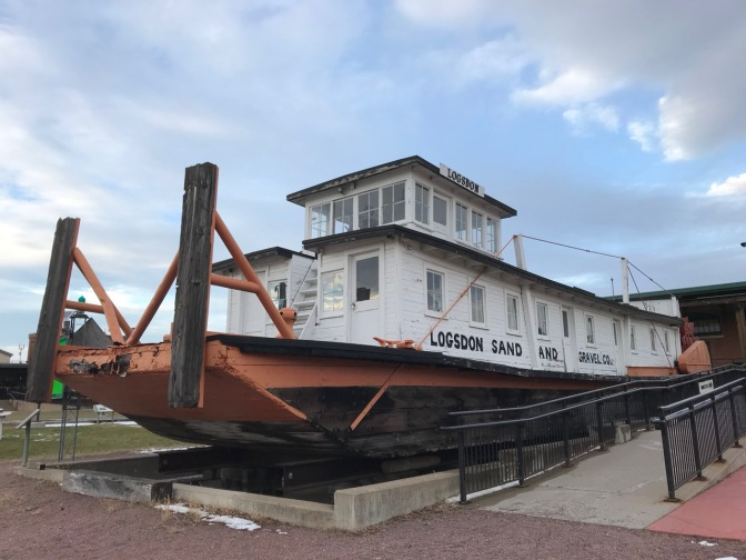 River boat in dry dock, with words on its side: LOGSDON SAND AND GRAVEL CO