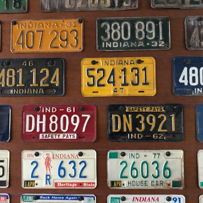 Wall covered in Indiana license plates.