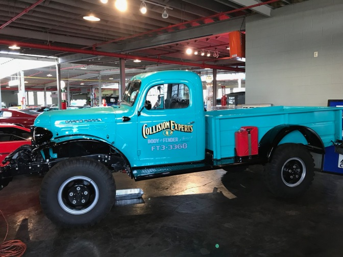 Blue Dodge Power Wagon pickup truck.