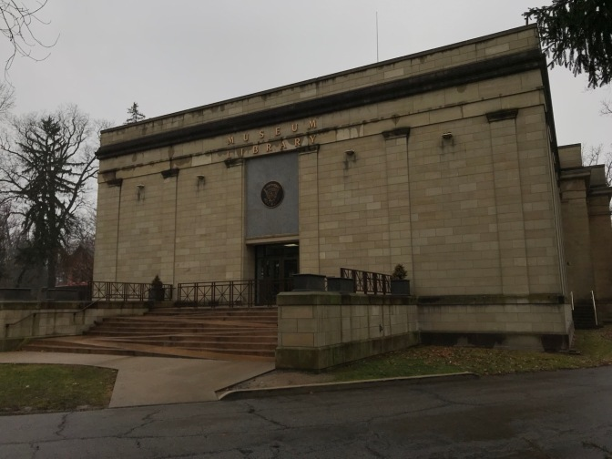 Exterior of museum, with concrete staircase with integrated handicapped access ramp.