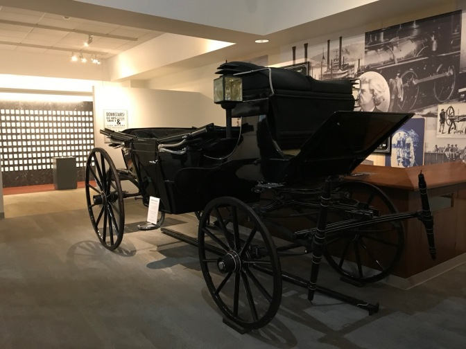 Black horse-drawn carriage.