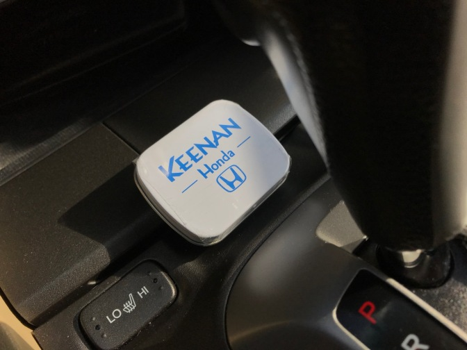 Case of mints on center console of 2012 Honda Accord.