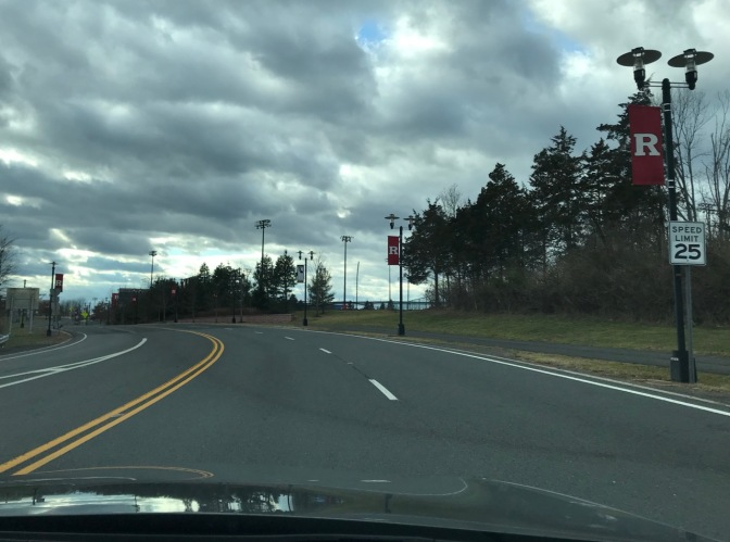 View of Route 18 in New Jersey with Rutgers flags hanging from light poles along side of road.