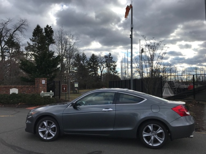 2012 Honda Accord parked in parking lot along entrance to walking path.