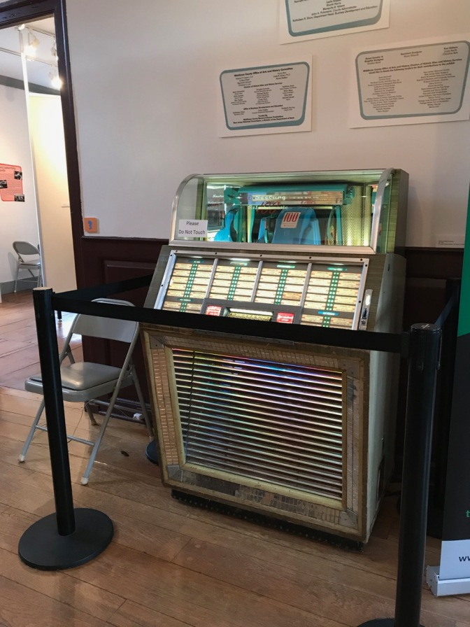 Jukebox in middle of hallway.