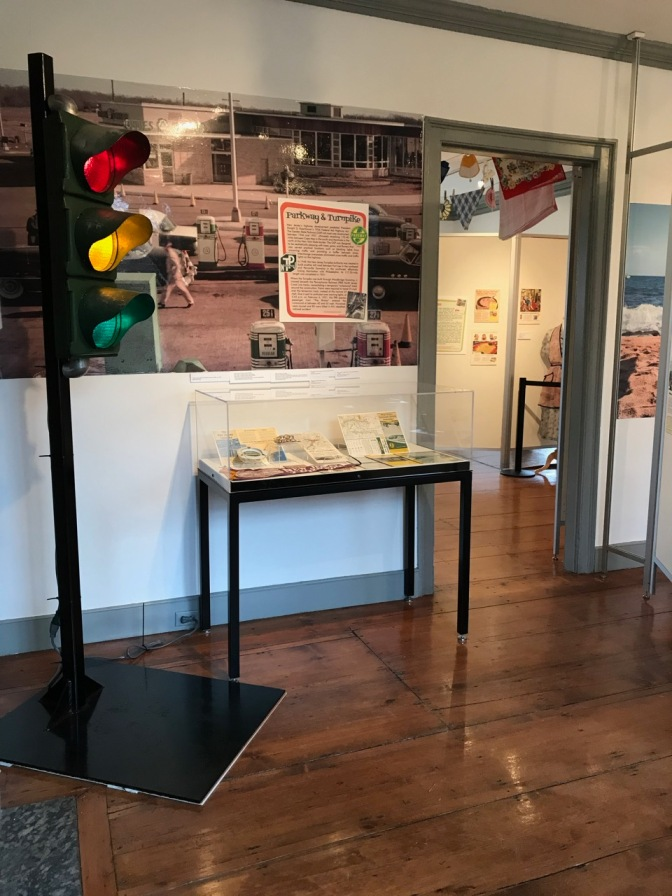 Room filled with exhibit on NJ Turnpike and Garden State Parkway. a traffic light stands in the corner.