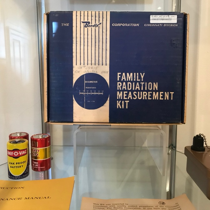 Display case with box of FAMILY RADIATION MEASUREMENT KIT