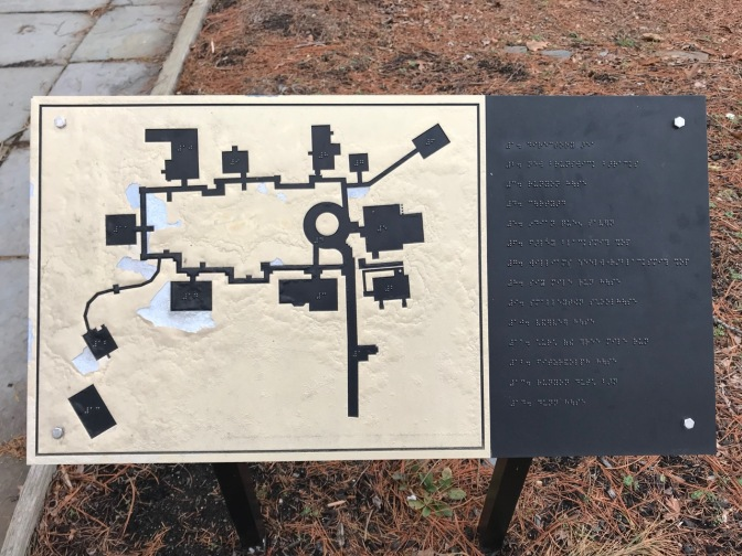 Sign with tactile map of village and braille signage.