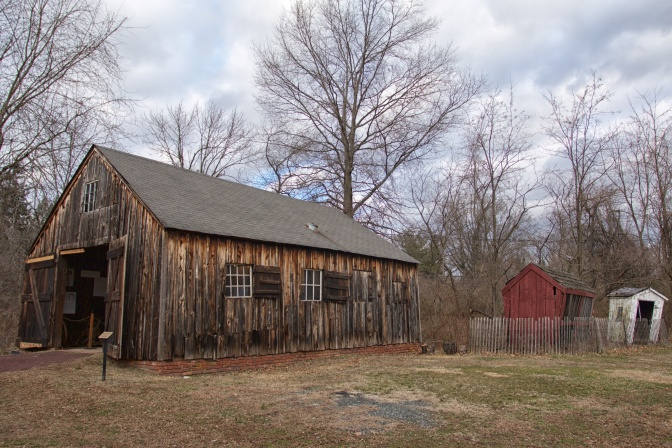 Exterior of Farley Blacksmitih Shop, with two smaller wooden sheds in background.
