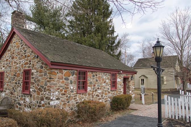 Stone one-room schoolhouse.