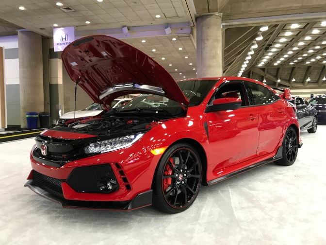 Red Honda Civic Type R with the hood up.