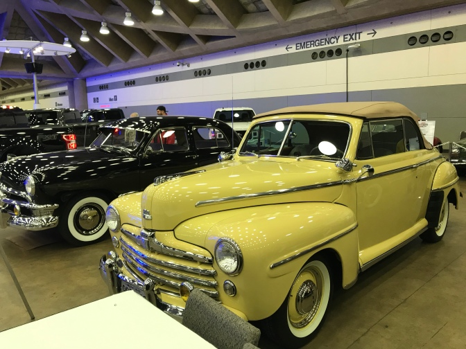 Yellow 1948 Ford Super DeLuxe convertible.