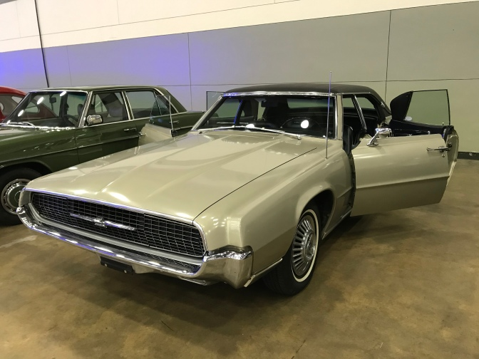 1967 Ford Thunderbird with doors open.