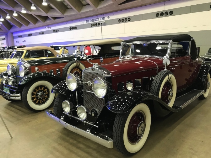 Classic Packard and Cadillac coupes.