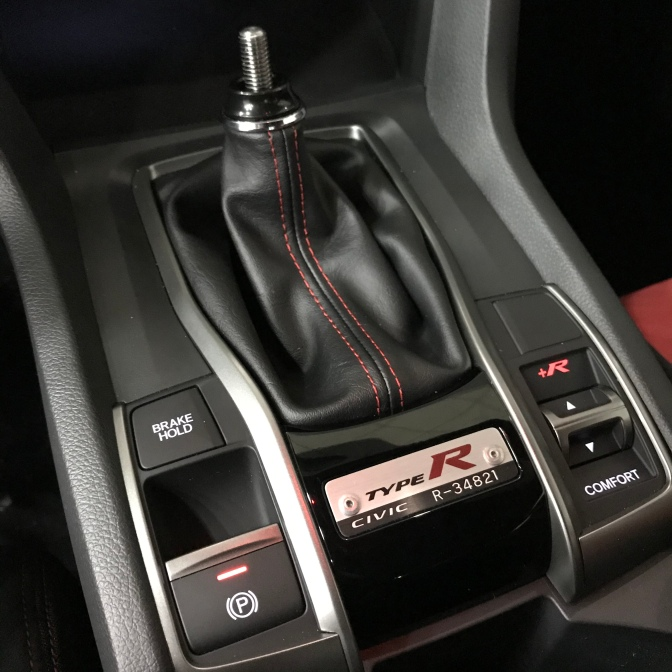 Shifter and center console with badge that says TYPE R CIVIC R-34821