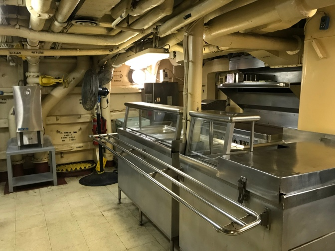 View of cafeteria buffet line and griddle in crew's mess.