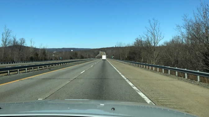 View of I-287 North through car windshield, on a clear and sunny day.