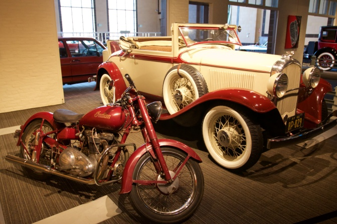 1949 Indian Scout motorcycle and 1932 Plymouth convertible.