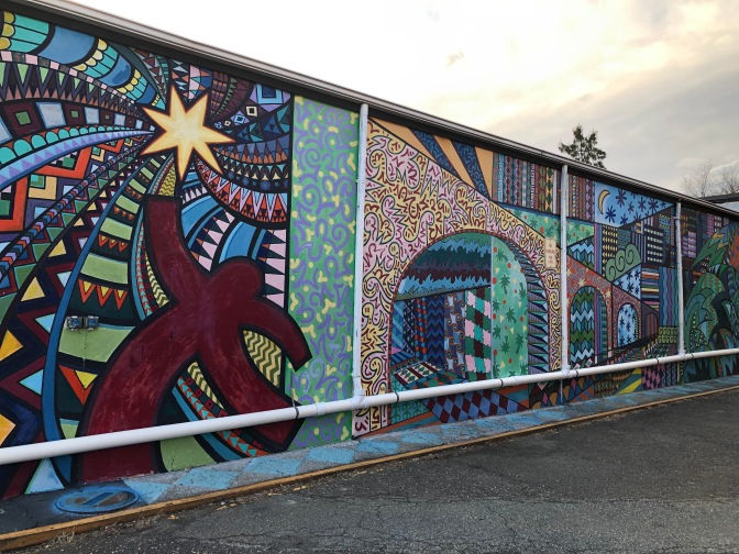 Mural with multiple shapes and patterns depicting New Brunswick and Highland Park.""