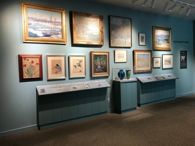 Artwork in museum displaying works from local artists in the late 19th and early 20th centuries.