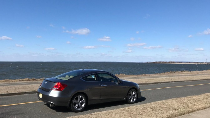2012 Honda Accord parked along road in Sandy Hook, with bay in background.