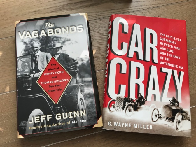 "Two books. On left, ""The Vagabonds"" by Jeff Guinn and on the right ""Car Crazy"" by G. Wayne Miller."