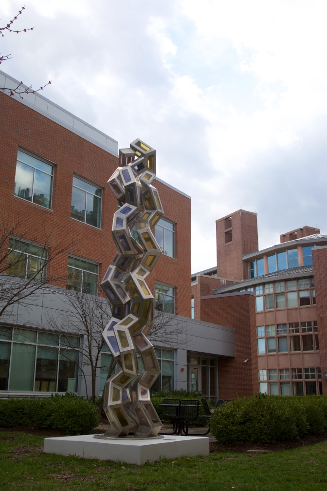 Sculpture of metal and colored glass.