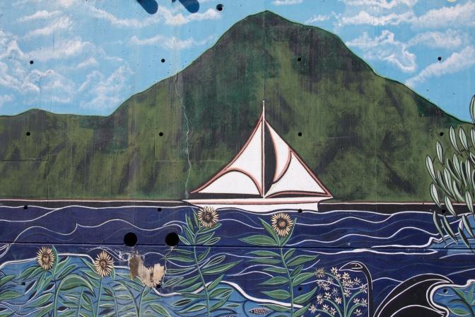 Sailboat sailing along river.