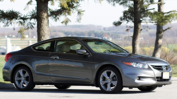 2012 Honda Accord park in front of trees, with rolling hills in background.