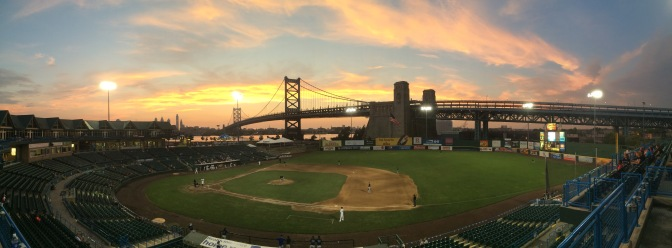Panoramic view of baseball field at sunset.