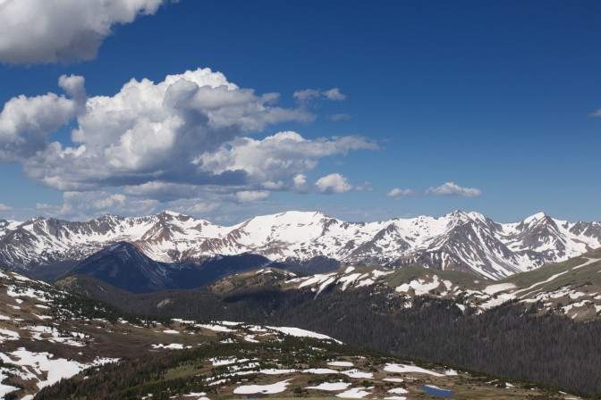 Rocky mountains under a blue sky with clouds.