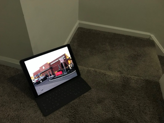 iPad on staircase, displaying a Starbucks coffee shop.