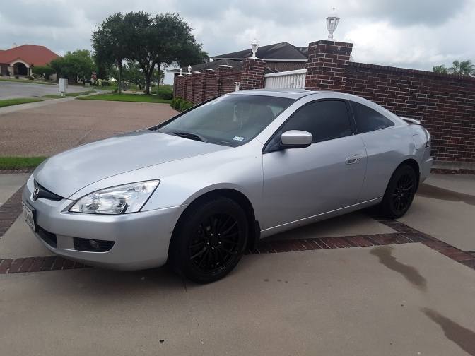 2003 Honda Accord coupe, in silver, parked in driveway.