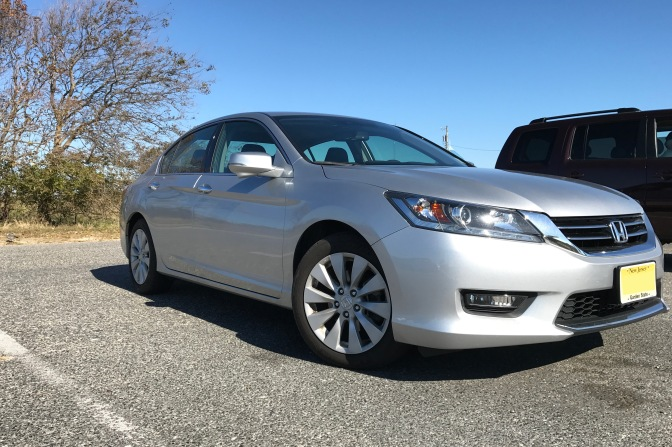 2015 Honda Accord sedan in silver, parked in parking lot.