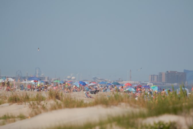 View of numerous people on beach.