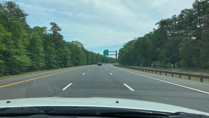 View of Garden State Parkway from behind dashboard of Jeep Grand Cherokee.
