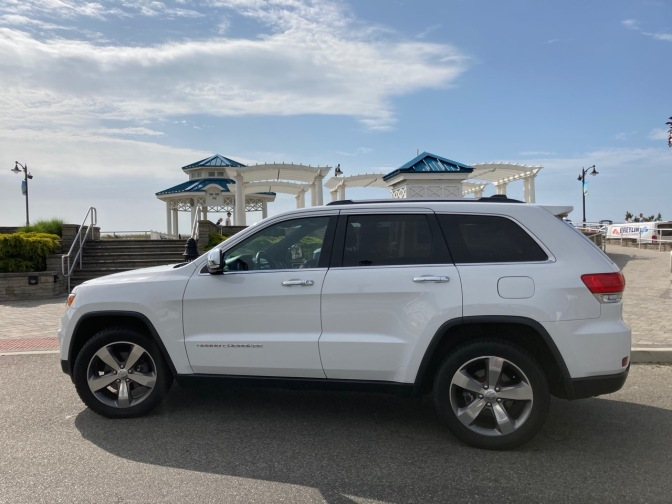 White Jeep Grand Cherokee in front of waterfront pavilions in Sea Isle City.