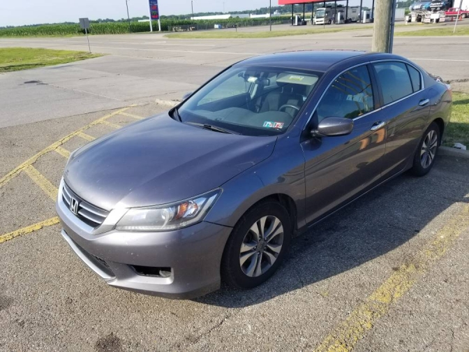 2015 gray Honda Accord LX parked in parking lot.