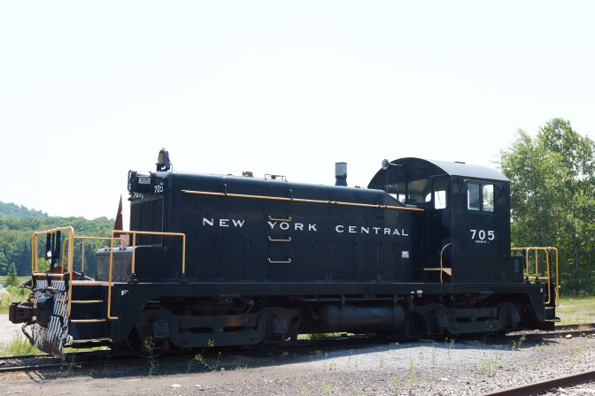 Black railroad engine with 705 written on side.