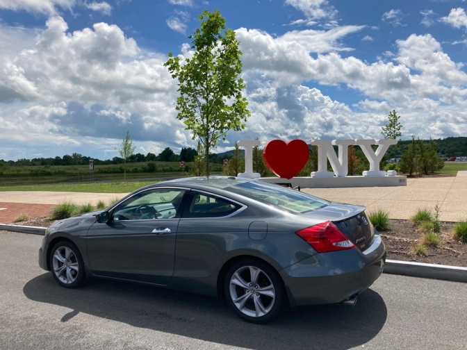 2012 Honda Accord coupe parked in front of sign that says I HEART NY.