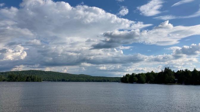 Blue skies over lake in Adirondacks.