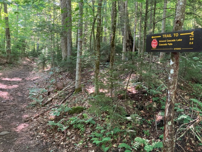 Trailhead with markers for Cascade Lake trail.