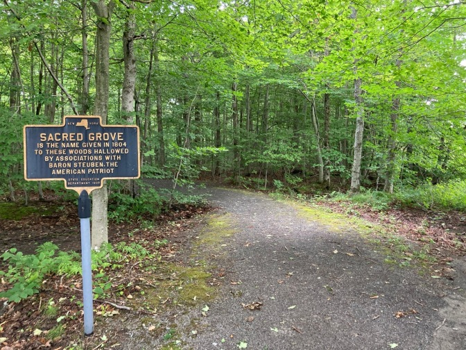 Sign by entrance to woods that reads SACRED GROVE is the name given in 1804 to these woods hallowed by associations with Baron Steuben, the American Patriot.