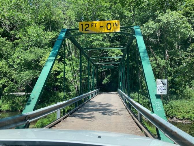 One-lane steel bridge over creek in Delaware Water Gap.