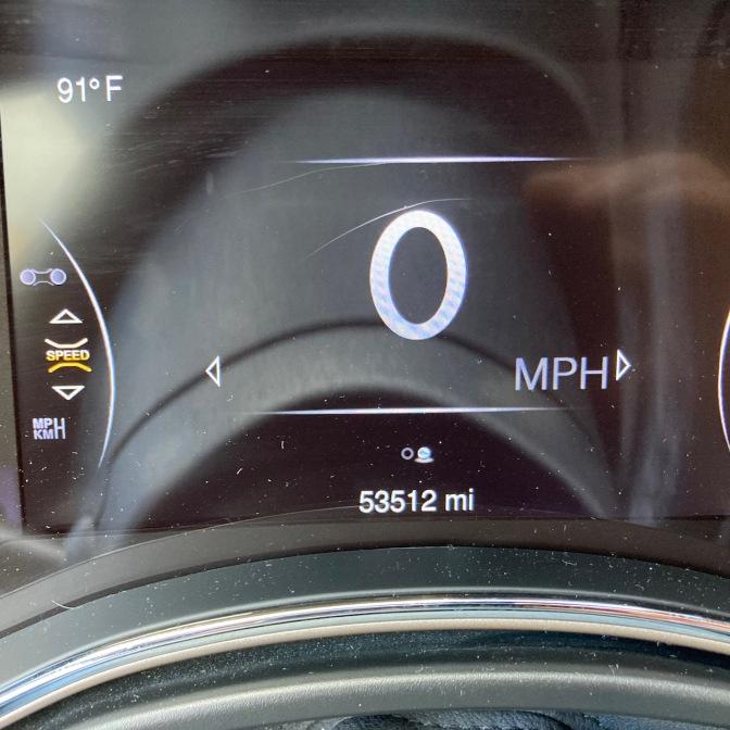 Car odometer reading 53512 miles.