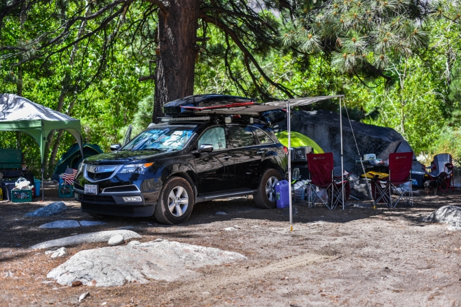 Black Acura MDX set up for camping.