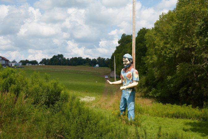 Hippie Muffler Man statue.